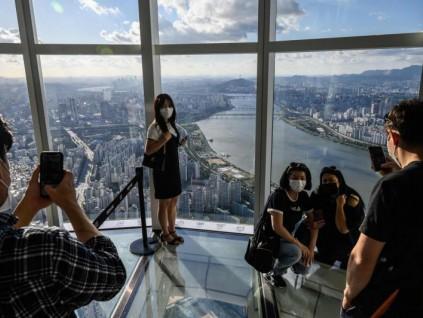 韩国疫情中秋后达新高 民众认为应与病毒共存